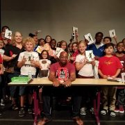 Picture of students and author, Kwame Alexander, at the Williamsburg Regional Library