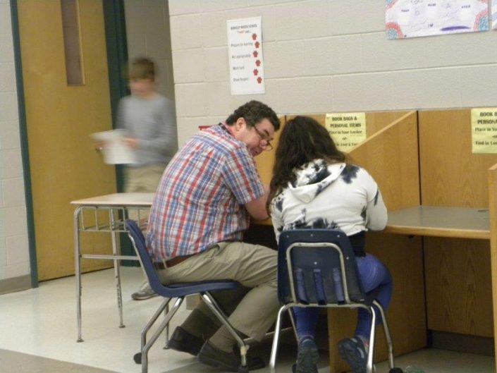 Teacher working one on one with a student during Write Talks.