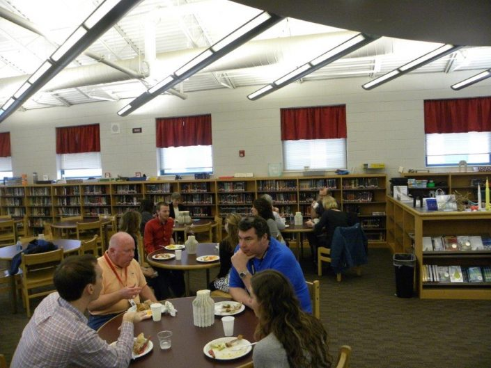 Write Talk Speakers and Proctors eating lunch in the library.