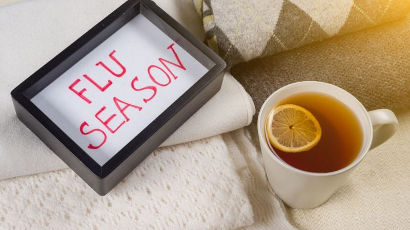 Cup of tea with a written sign saying Flu Season