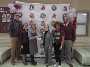 On behalf of James Blair, Ms. Moore receives a $500 minigrant from Ms. Adolphi and Ms. Wade of the Williamsburg Chapter NSDAR. Ms. Moore is thankful for the support shown by Mr. Burkart and Mrs. Haskins and for the efforts of Mr. Legawiec, WJCC Social Studies Coordinator, whose communication and flexibility made this grant possible.