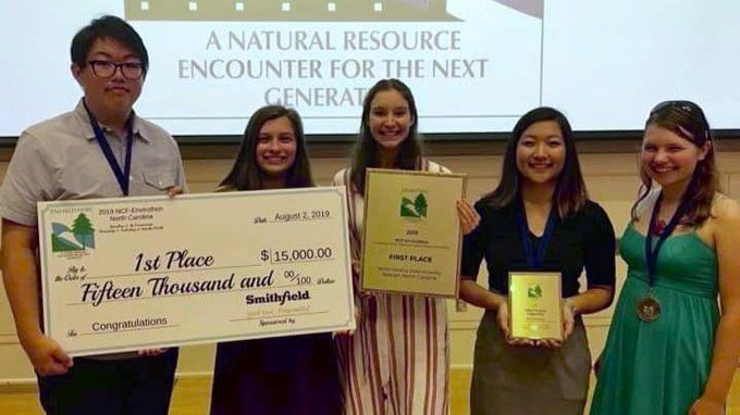 Members of the JHS Envirothon Team pose with a check for $15,000 in scholarship money as their prize for winning the International Envirothon Comepition