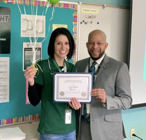 Jenny March and Howard Townsend with Rookie Teacher of the Year certificate