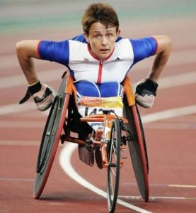 woman in a wheelchair racing