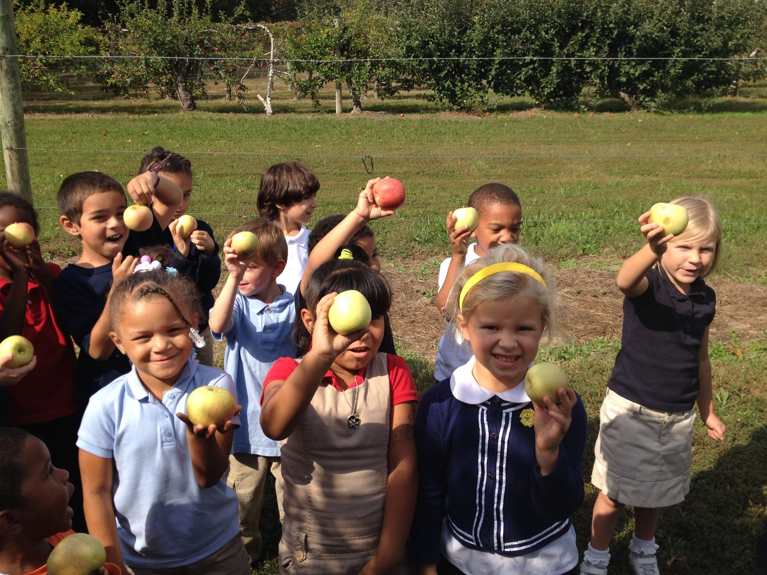 students holding apples
