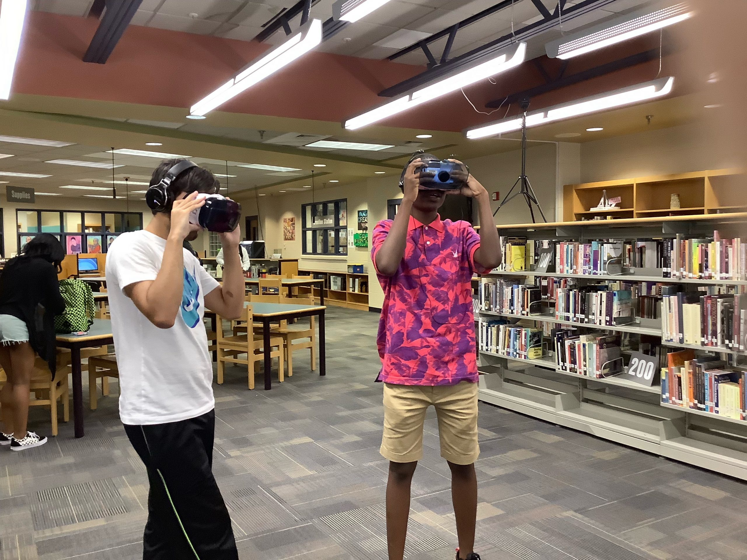 Students looking into VR viewers.
