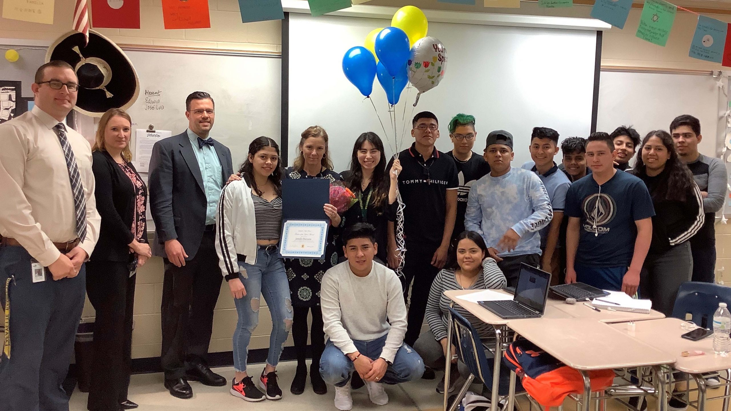 Jennifer Marzana poses with her class and LHS administration.