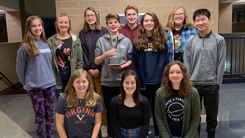 Scholastic Bowl members pose with their regional trophy.