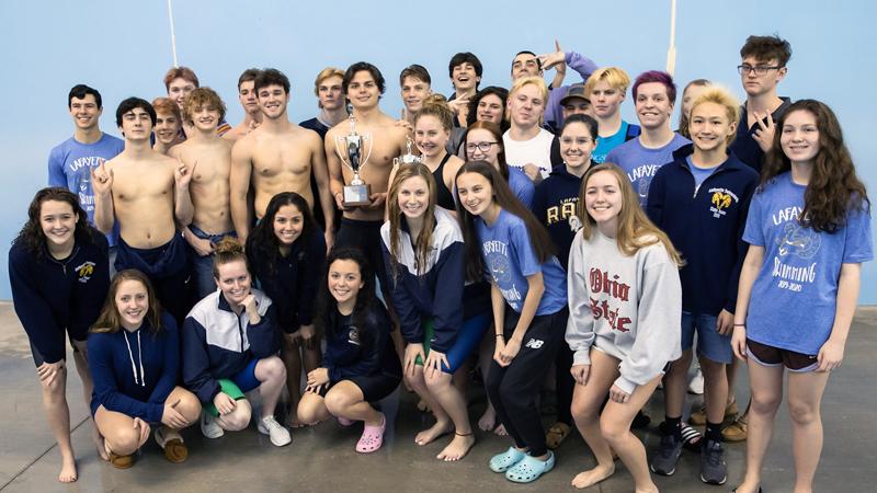 Boys and Girls Swim Teams Pose with Regional Trophy.