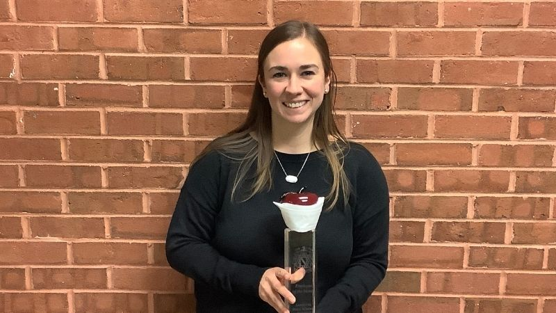 Mrs. Brooke Reese pictured holding the Employee of the Month trophy.