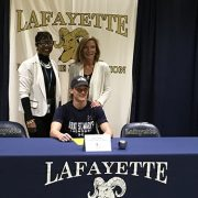 Matthew Rice signs college scholarship.