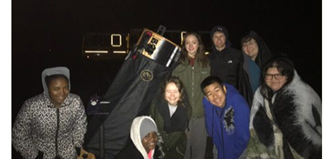 LHS students pictured around Mr. Moore's telescope