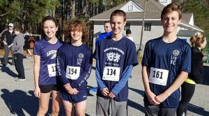 Cross country team members participated in the RamFam 5K.