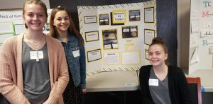LHS students with their display board at the science board..