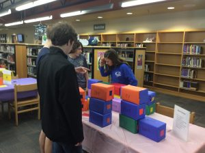 Students build poems with blocks.