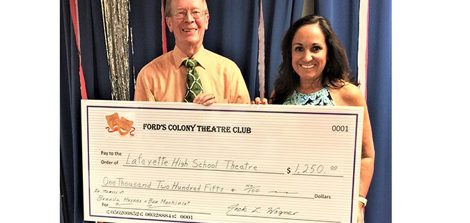 Jack Wagner, Ford's Colony Theatre Club President, presents a check for $1,250.00 to Suzan McCorry, Layfette HS Theatre Director.