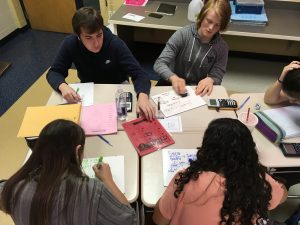 Group of students work to solve the trigonometry puzzles.