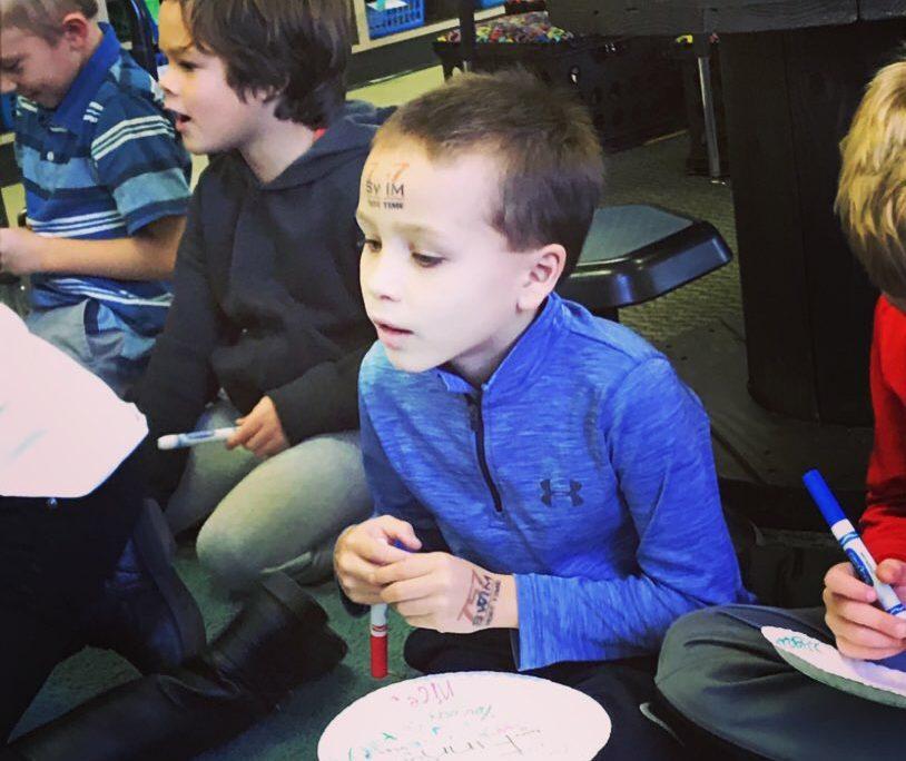 boy in blue long sleeve