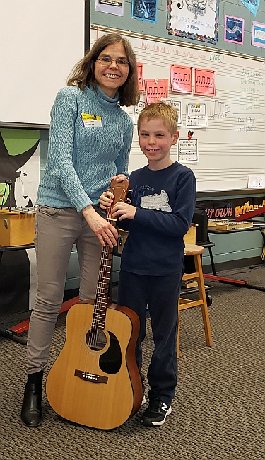 student in music class