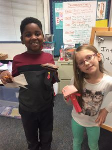 """Students share their """"Famous Americans"""" projects on Martin Luther King, Jr. and Rosa Parks."""