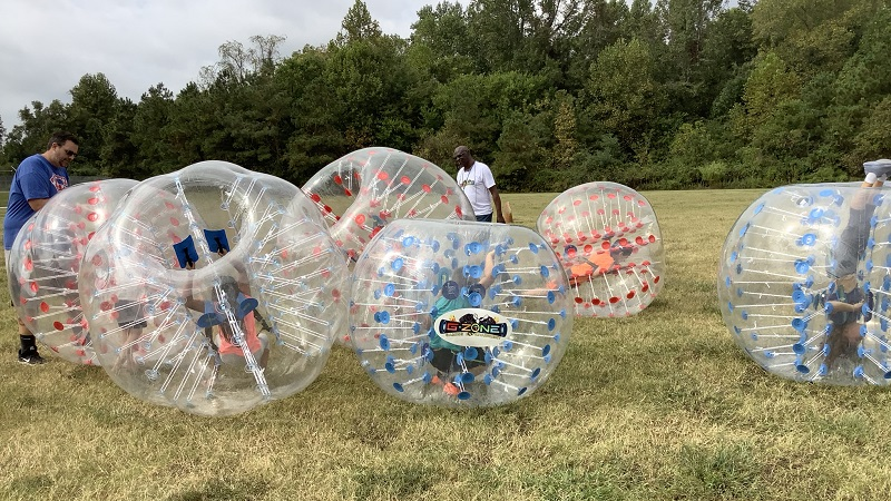 Children rolling in blow up balls