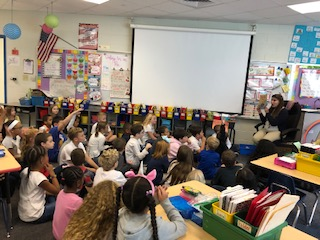 Teacher reads to the classes.