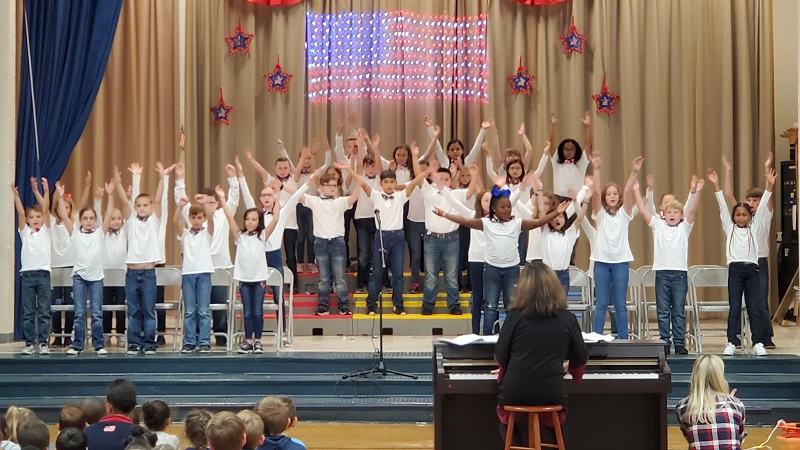 Students perform songs for Veterans Day.