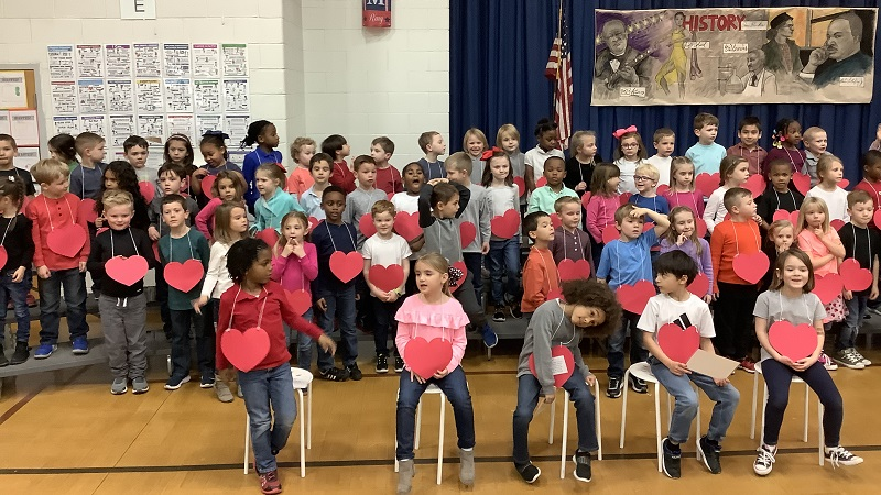 K Students sing.