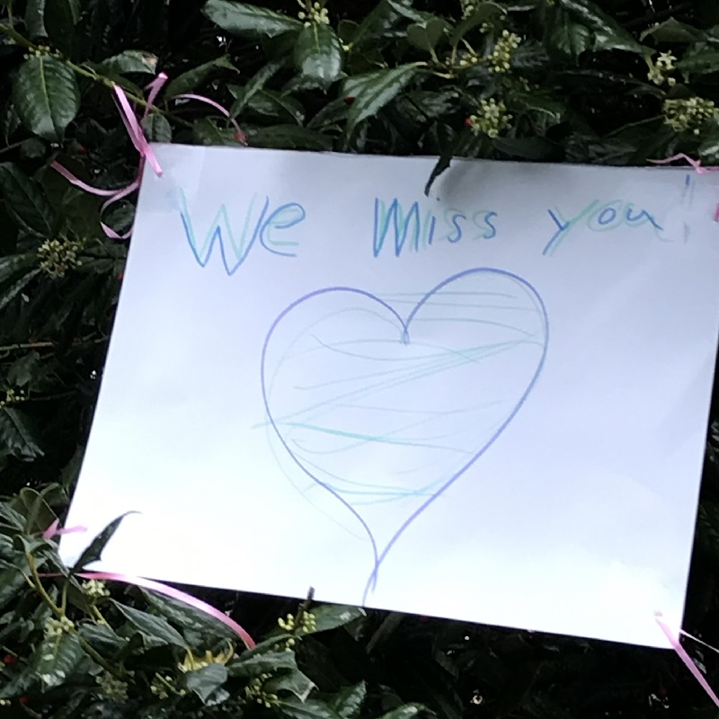 """We Miss You"" sign."