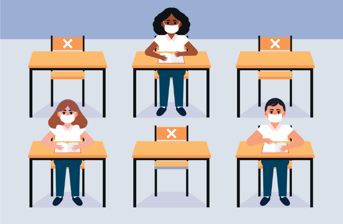 Cartoon children sitting at socially distant desks