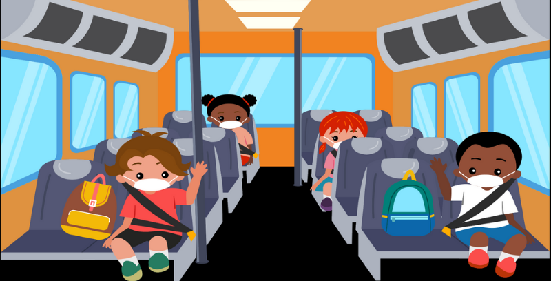 Students sitting on a bus socially distanced