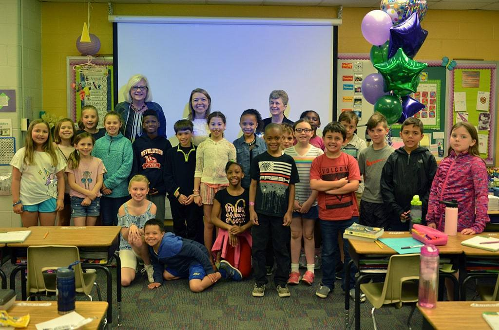 Abby Reynolds - Elementary Teacher- of the Year with students in classroom