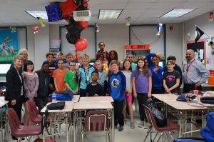 Mary Glisan - Middle Teacher of the Year with students in the classroom