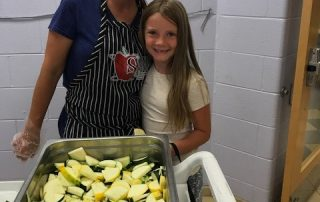 WJCC Schools staff member and student on Farm to School Try Day
