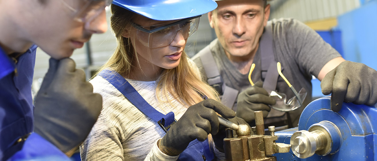 Female student working with machinery
